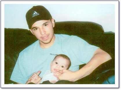 Isidro Jamil Ortiz with a friends baby.